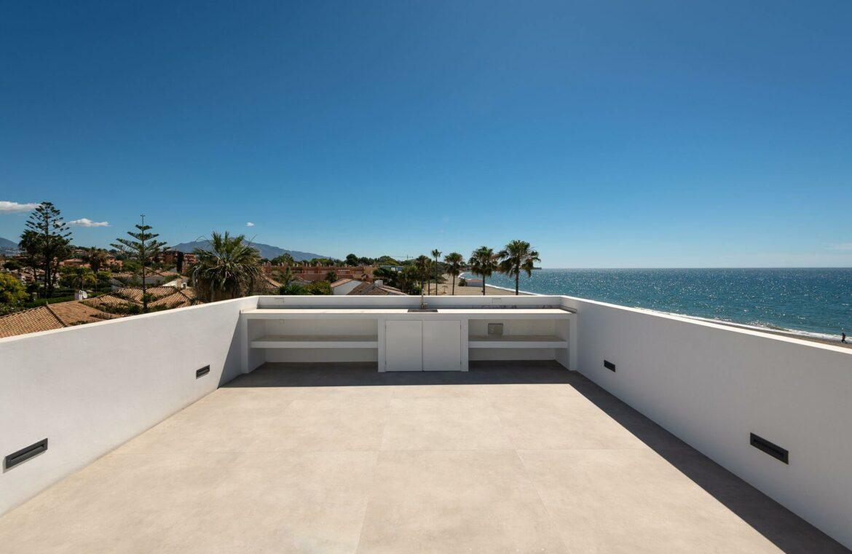 villa imare new golden mile estepona costa del sol spanje eerstelijns zee strand nieuwbouw villa buitenkeuken